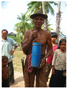 Many villagers are adept at shimmying up palm trees; they drink the juice and make palm sugar & wine. Takeo Province by Breth Matthews