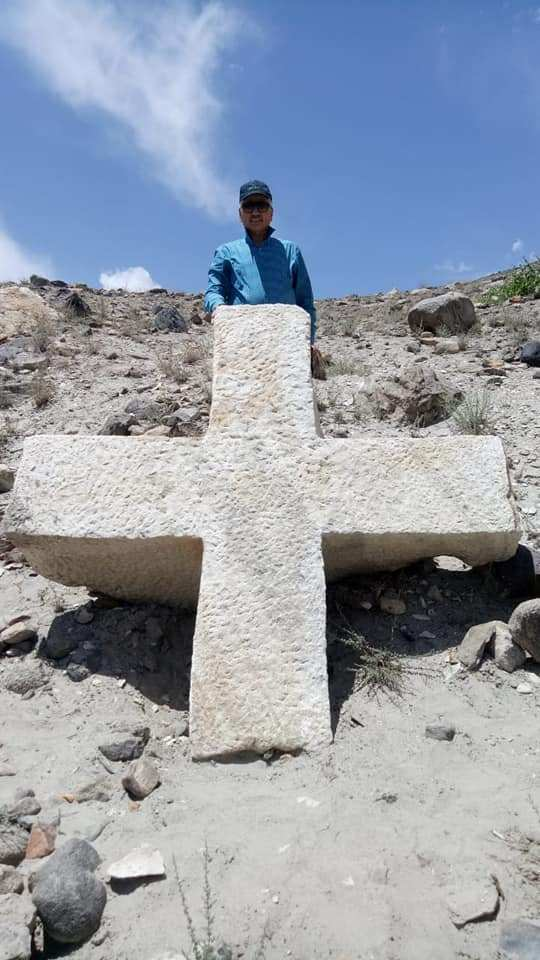 Dr. Naeem Khan posing with the cross